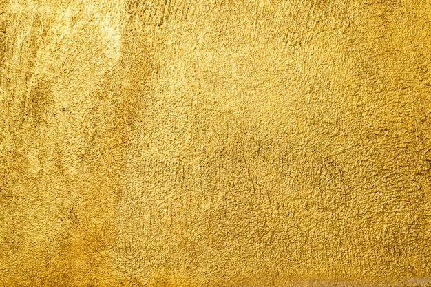 Fondo de textura de pared dorada.