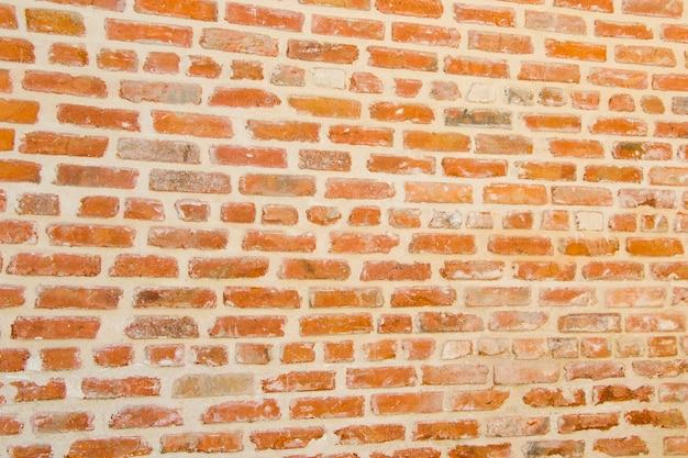 Fondo y textura de la pared de ladrillo antiguo, luz natural y al aire libre
