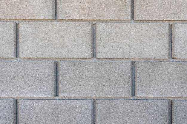 Fondo de textura de pared de ladrillo de hormigón gris grande, material de construcción industrial.