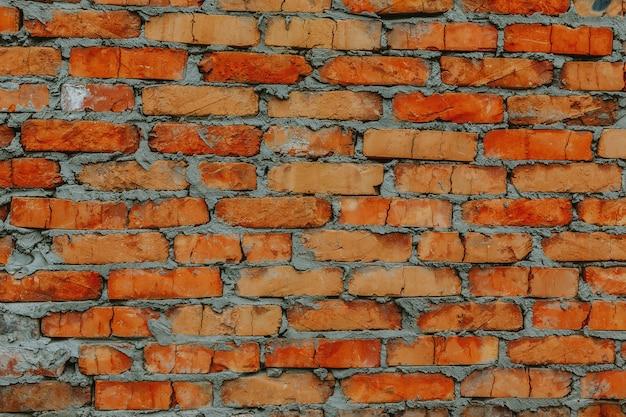 Fondo de textura de pared de ladrillo rojo con cemento gris