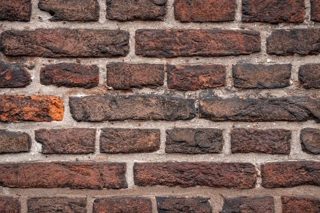 Fondo de textura de pared de ladrillo rojo viejo. clásico.
