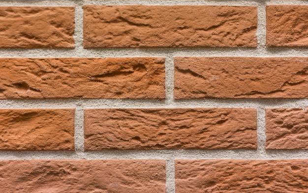 Fondo de textura de pared de piedra de ladrillos de azulejo rojo