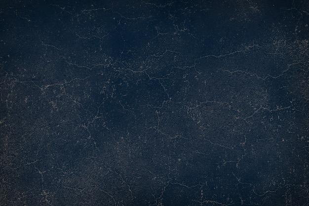 Fondo de textura de pared sucia agrietada azul marino