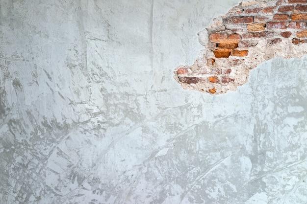 Fondo de textura de paredes de cemento y viejas grietas de ladrillo en la pared