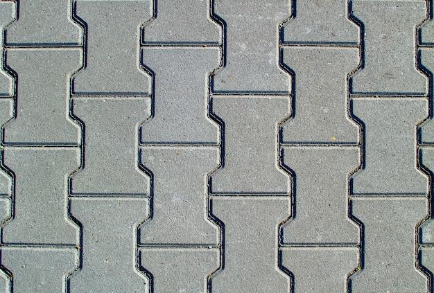 Fondo de textura de pavimento de hormigón o acera con losas de pavimentación