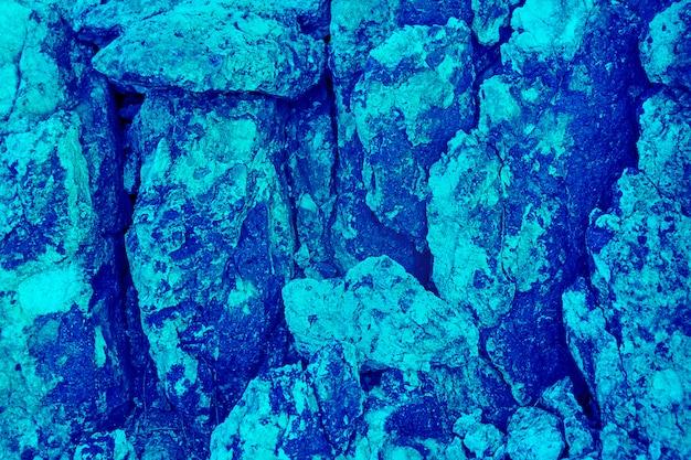 Fondo y textura de piedra azul aguamarina, patrón natural coloreado