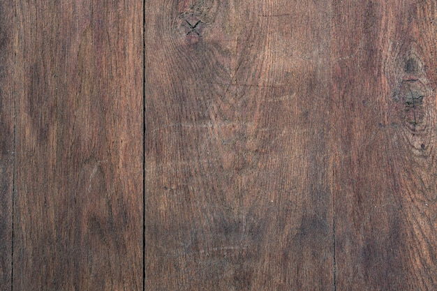 Fondo y textura de la placa de madera marrón.