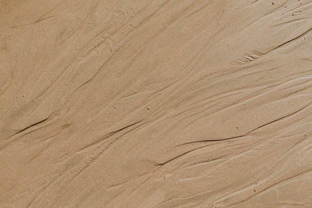 Fondo de textura de playa de arena beige