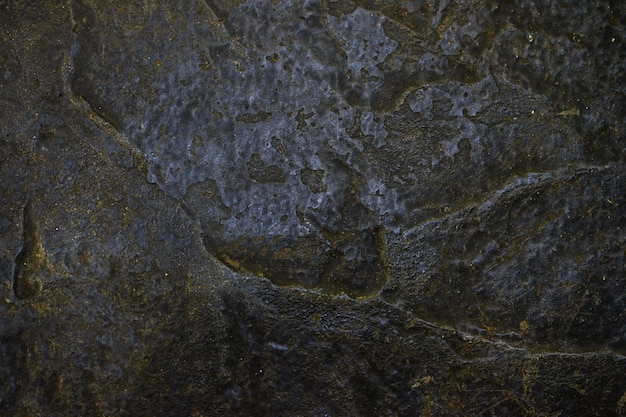 Fondo de textura de roca o piedra en vista oscura