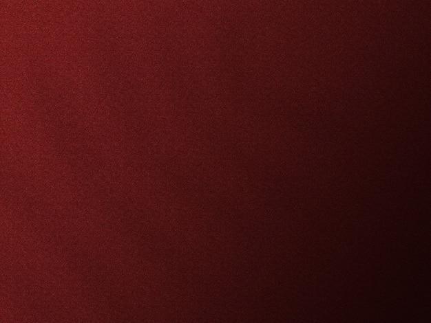 Fondo de textura rojo oscuro con sombra de hojas