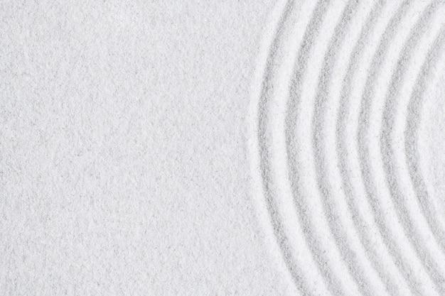 Fondo de textura de superficie de arena blanca zen y concepto de paz