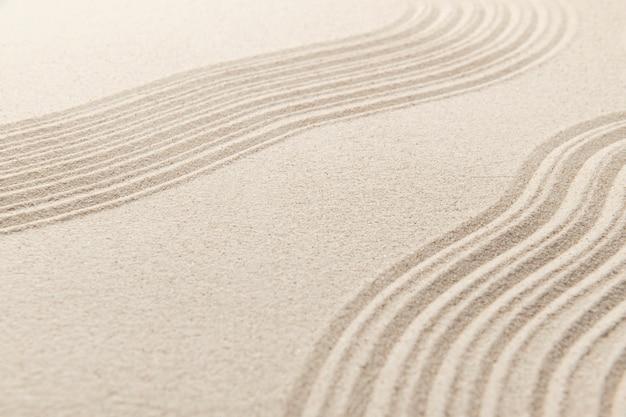 Fondo de textura de superficie de arena zen y concepto de paz