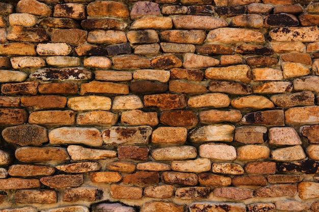 Fondo y textura de la superficie de la pared de piedra del granito.