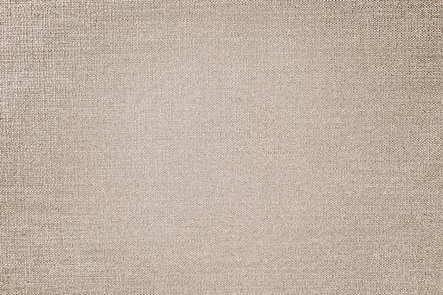 Fondo de textura de tela de algodón dorado