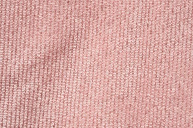 Fondo de textura de tela de tela rosa de cerca