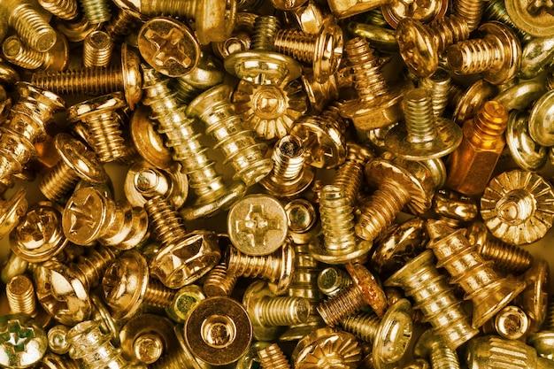 Fondo de textura de tornillos de oro y oro de computadora