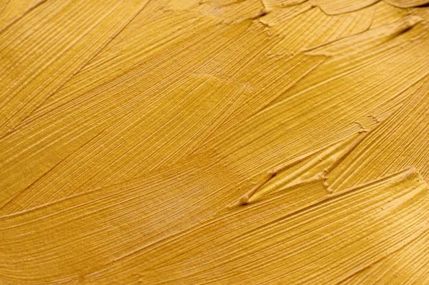 Fondo de textura de trazos de pincel de pintura dorada abstracta