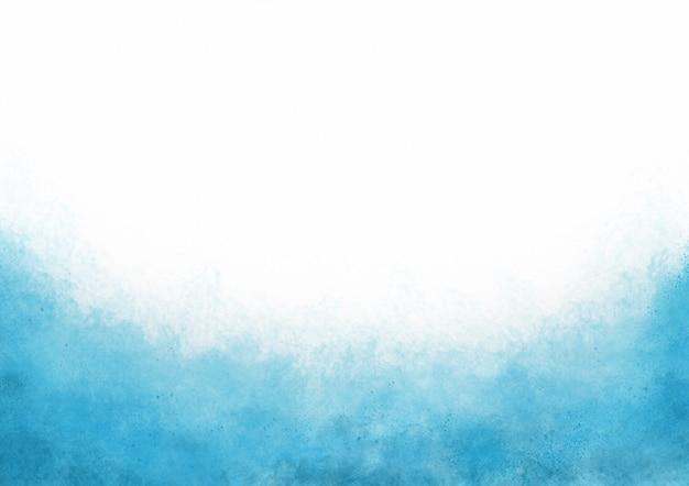 Fondo de tinta de salpicaduras de acuarela azul abstracto se desvanecen sobre papel blanco con espacio de copia y tema del océano