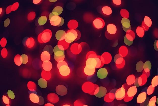 Fondo de tonos bokeh borrosa de luces de colores garland