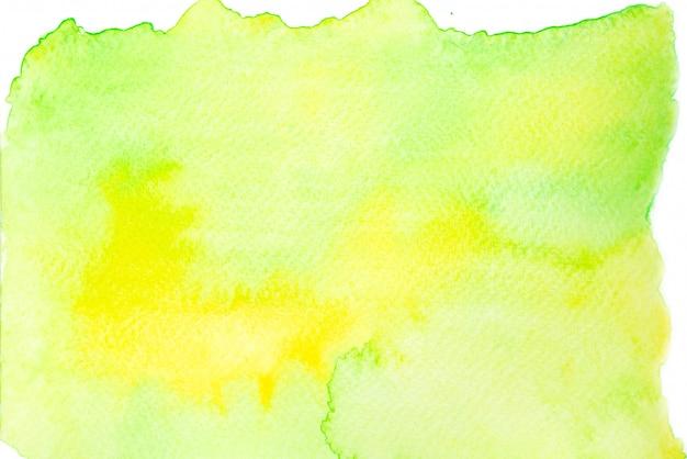 Fondo de trazo de pintura de mancha de acuarela verde y amarillo