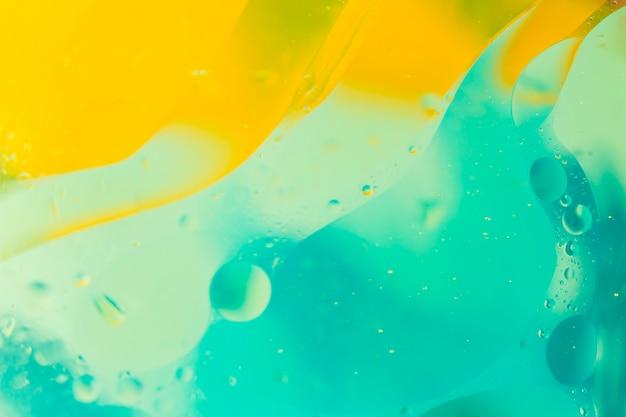 Fondo turquesa y amarillo con burbujas