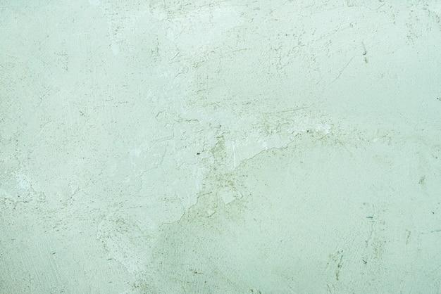 Fondo verde celadón vintage o sucio de cemento natural o textura antigua de piedra como una pared de patrón retro. grunge, material, envejecido, construcción.