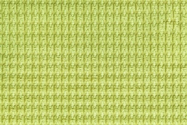 Fondo verde claro del cierre suave de la tela lanosa para arriba. textura de macro textil
