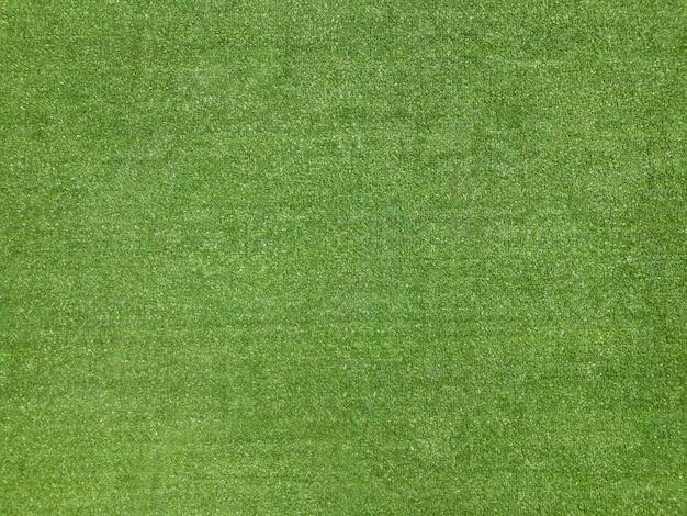 Fondo verde de la textura de la hierba falsa del campo de fútbol