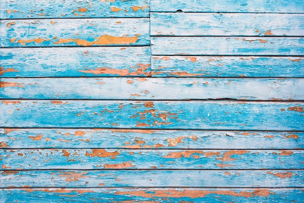 Fondos de textura de madera vieja azul, naranja. rayas horizontales, tablas. asperezas y grietas.