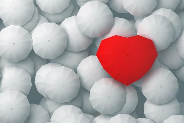 En forma de corazón de paraguas rojo que se eleva sobre otros paraguas.