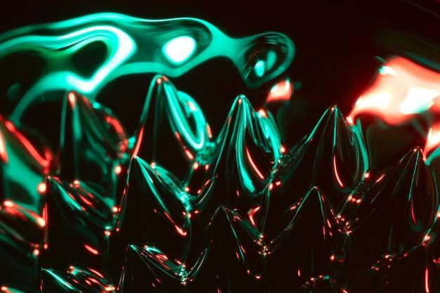 Forma ferrofluídica magnética con tonos verdes.