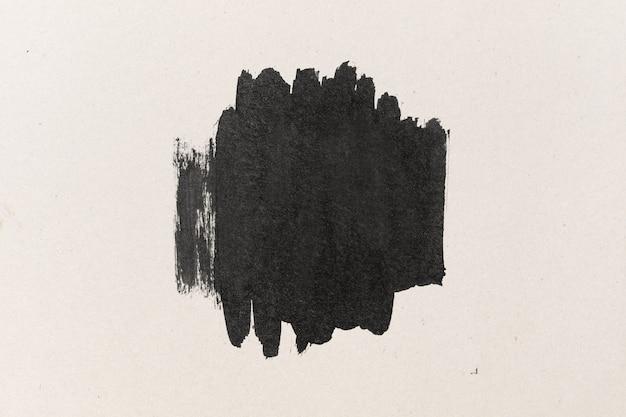 Forma de tinta negra sobre fondo de textura de papel de color de agua