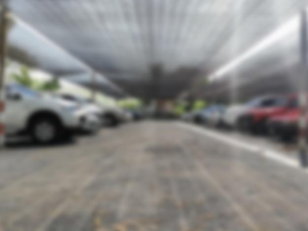Foto borrosa de autos en el estacionamiento, autos estacionados en el estacionamiento