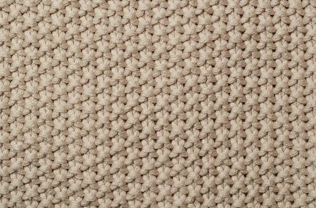 Foto macra del modelo de la tela, cierre para arriba de la ropa de la materia textil.