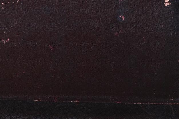 Foto macra de una vieja textura de la cubierta de libro negro