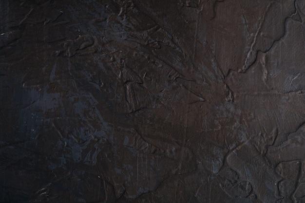 Foto de superficie creativa con textura oscura en colores grunge negro, marrón y azul, pintura y salpicaduras telón de fondo