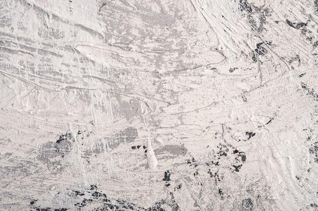 Foto de superficie con textura brillante creativa en colores grunge blanco, gris y negro, telón de fondo de pintura y gotas de salpicadura