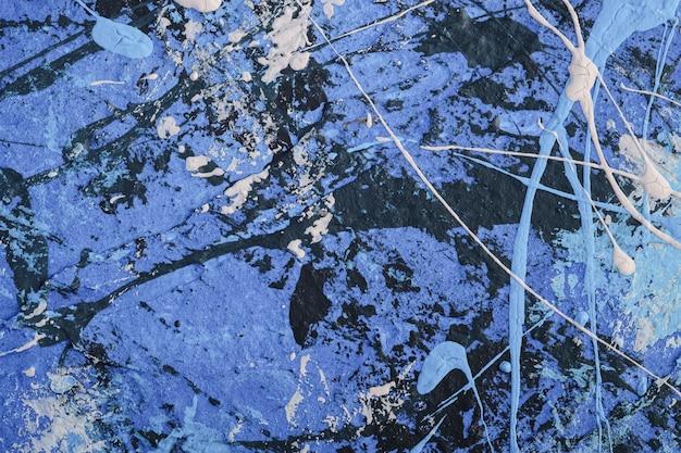Foto de superficie con textura creativa en colores pastel azul, blanco y negro grunge, pintura y salpicaduras telón de fondo