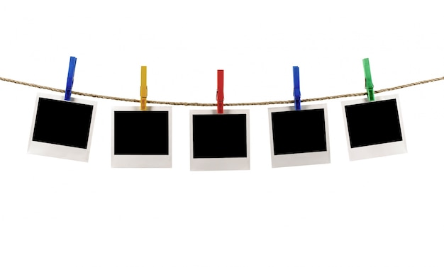 Fotos en una cuerda con pinzas de ropa