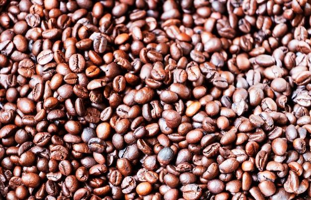 Fotos de primer plano de granos de café para el fondo