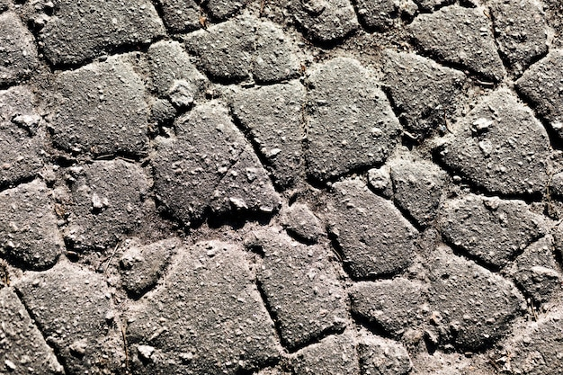 Fragmento de una pared de una piedra astillada
