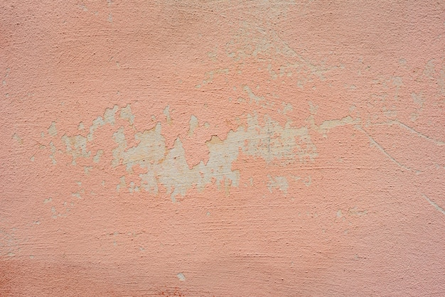 Fragmento de pared con rasguños y grietas de fondo.
