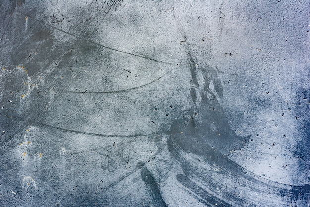 Fragmento de pared con rasguños y grietas de fondo
