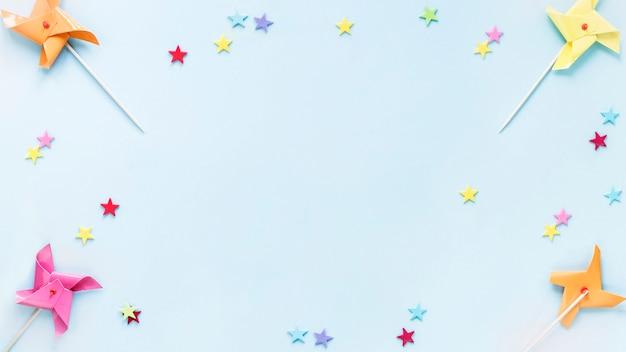 Frontera de confeti y molinetes