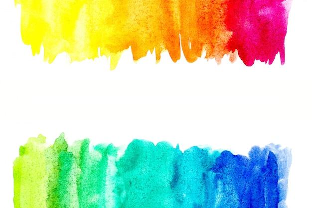 Frontera de la pintura abstracta de la mano del arte de la acuarela en el fondo blanco.