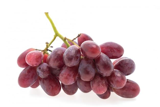 Fruta de las uvas aislada en el fondo blanco