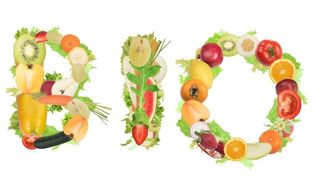 Las frutas y verduras forman la palabra bio. alimentos saludables para el concepto de bienestar