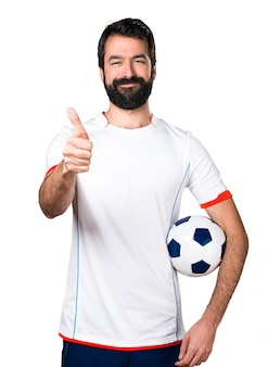 Futbolista, tenencia, fútbol, pelota, pulgar, arriba