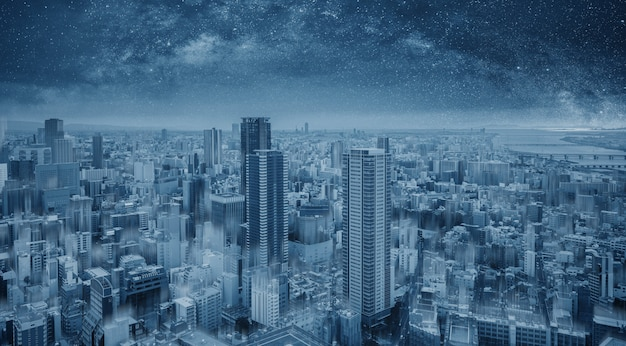 Futurista ciudad inteligente azul en la noche, cielo estrellado