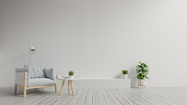 Gabinete de tv en la moderna sala de estar con sillón sobre fondo de pared blanca.